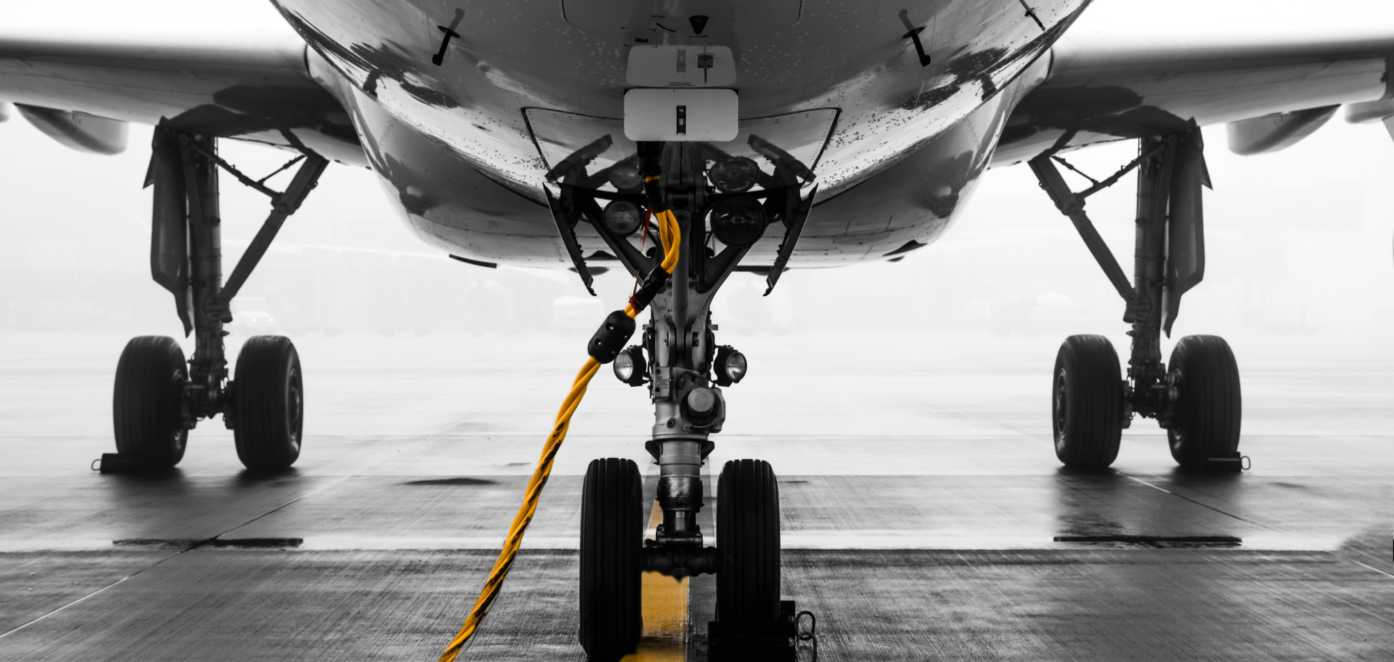 gray-air-vehicle-with-yellow-coated-cable-around-docking-2315265